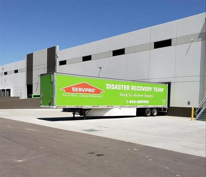 Large green SERVPRO  semi trailer